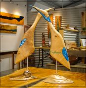 Brolga sculpture handcrafted in Jacaranda on a Queensland Maple Burl base featuring pearl turquoise resin inlays